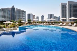 The swimming pool at or near Mövenpick Hotel Apartments Downtown Dubai