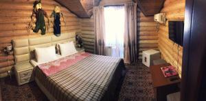 Кровать или кровати в номере Гостевой дом «Русский»