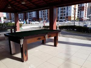 A pool table at Ap Beija Flor