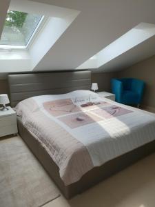 Postel nebo postele na pokoji v ubytování Wellness Apartmány EMPORIO