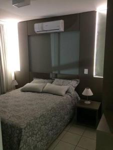 A bed or beds in a room at Apto no Serra Madre Residence