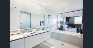 A bathroom at Cavill Avenue Luxury Private Apartments