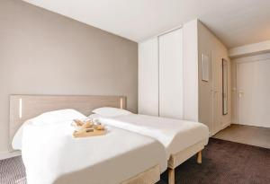 A bed or beds in a room at Appart'City Lyon Part Dieu Villette
