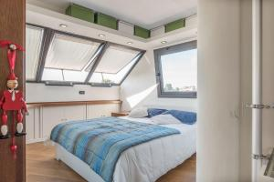 A bed or beds in a room at Torlonia Exclusive Penthouse