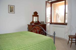 A bed or beds in a room at Casa Lella