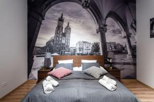 Posteľ alebo postele v izbe v ubytovaní Cracow Rent Apartments