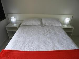 Cama o camas de una habitación en Apartamento de 02 Quartos