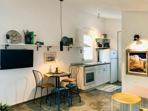 A kitchen or kitchenette at Armonia Villas