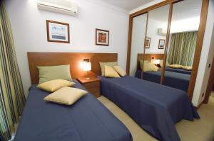 A bed or beds in a room at Interpass Alvaflor