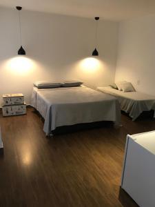 A bed or beds in a room at Casa com suítes em Brasília