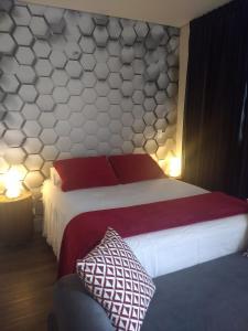 Cama ou camas em um quarto em Studio Centro São Paulo