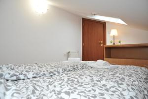 A bed or beds in a room at Three Hearts Apartment