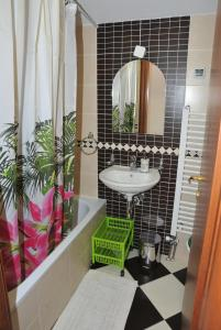 A bathroom at Three Hearts Apartment