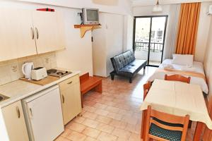 A kitchen or kitchenette at Poseidon Hotel and Apartments