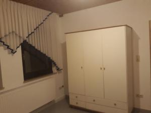 A television and/or entertainment center at Wohnung