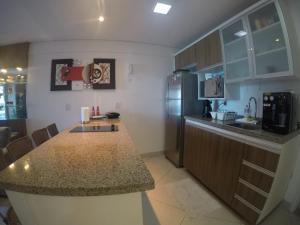 A cozinha ou cozinha compacta de Landscape By Frente Mar