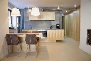 A kitchen or kitchenette at Apartamenty Snow & Fun