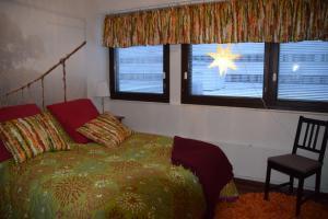 Vuode tai vuoteita majoituspaikassa Home Ainola
