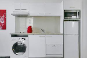 A kitchen or kitchenette at Quest South Brisbane