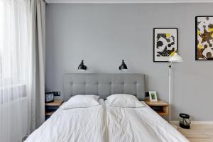 Lova arba lovos apgyvendinimo įstaigoje Apartamenty Apartinfo Sadowa