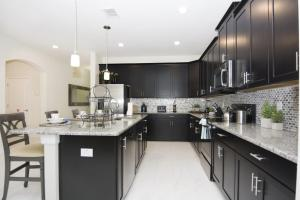 A kitchen or kitchenette at Dream Vacation Home Close to Disney SL4788