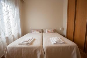 A bed or beds in a room at Porto Gaia City and Beach by MP
