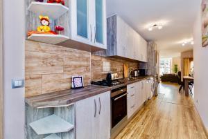 A kitchen or kitchenette at Malaga Plaza de Torros Apartment by Rafleys