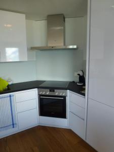 A kitchen or kitchenette at Residence Ski Heaven