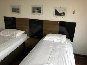 A bed or beds in a room at Grande Ap Central