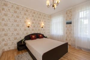 A bed or beds in a room at Amber Coast & Sea