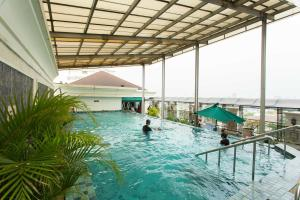 The swimming pool at or near Roosseno Plaza Serviced Apartment