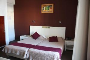Кровать или кровати в номере Kings Annex