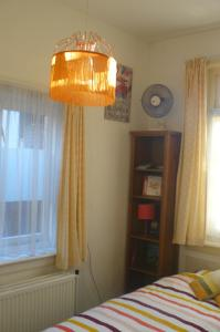 Een bed of bedden in een kamer bij Amsterdam Beach Apartment