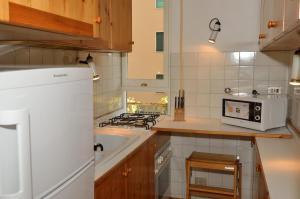 A kitchen or kitchenette at La Maison Di Marianna