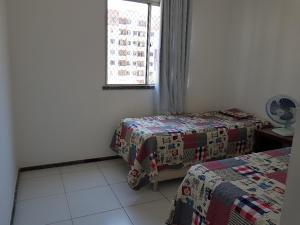 A bed or beds in a room at condominio caminho dos ventos Aruana Aracaju SE