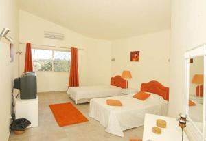 A seating area at Estombar Villa Sleeps 12 Pool