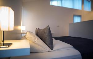 A bed or beds in a room at Apartment by the Sea near Reykjavik Center