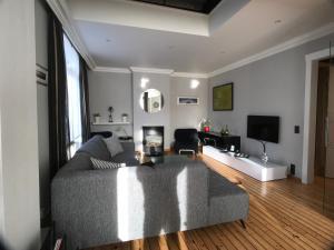 Ein Sitzbereich in der Unterkunft Appartement Belle Époque