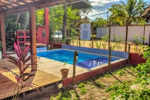 The swimming pool at or near Embaú Flats & Suites