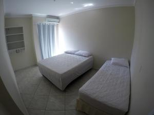 A bed or beds in a room at Recanto do Sossego Residence