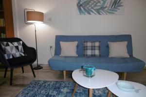 A seating area at Bright, Elegant Apartment