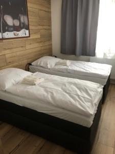 Posteľ alebo postele v izbe v ubytovaní Apartmán Mateo Jasná