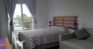 Una cama o camas en una habitación de Aluminé