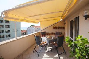 A balcony or terrace at Apartman Bepina