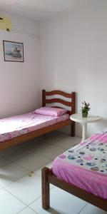 A bed or beds in a room at Apartamento Boa Viagem
