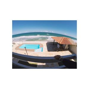 A view of the pool at Casa em Condomínio Barra São Miguel or nearby