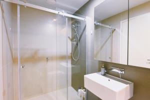 A bathroom at HFN Southern Cross Apartment