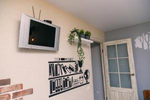 Телевизор и/или развлекательный центр в Loft Design Apartment