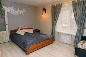 Кровать или кровати в номере Loft Design Apartment