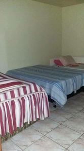Cama o camas de una habitación en Casa temporada na praia de Atlântida Sul
